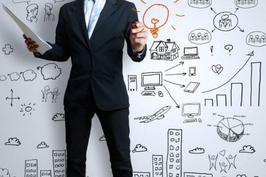 businessman with marker writing something - Image